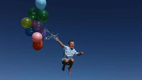 Boy with balloons, slow motion Royalty-free stock video