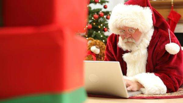 Santa Claus typing on laptop computer Royalty-free stock video