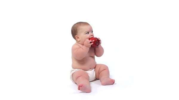 Baby on white background with apple Royalty-free stock video