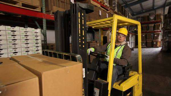 Forklift operator in a shipping warehouse Royalty-free stock video