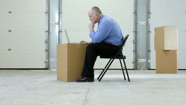 Business man in warehouse with laptop on cardboard box Royalty-free stock video