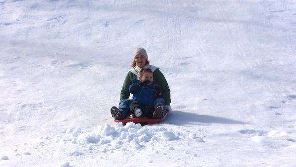 Mother and son riding sled, slow motion Royalty-free stock video
