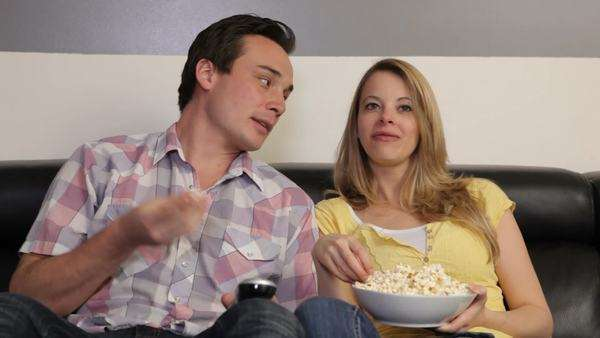 Couple in living room watching television together Royalty-free stock video