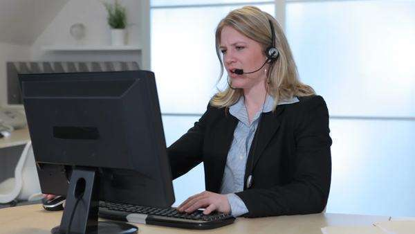 Portrait of business woman in office with headset Royalty-free stock video