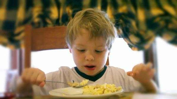 Young boy eating cereal for breakfast Royalty-free stock video
