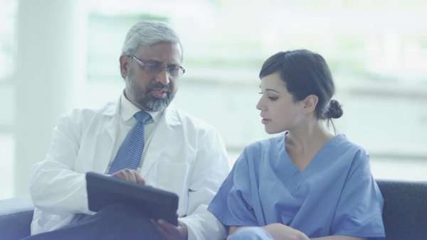 Medical professionals discussing something on a tablet Royalty-free stock video
