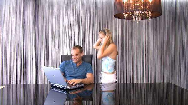 Attractive young couple listening to music online Royalty-free stock video