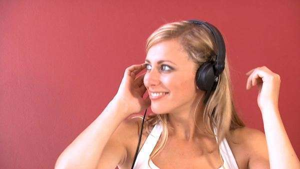 Attractive young woman listening to music through headphones Royalty-free stock video
