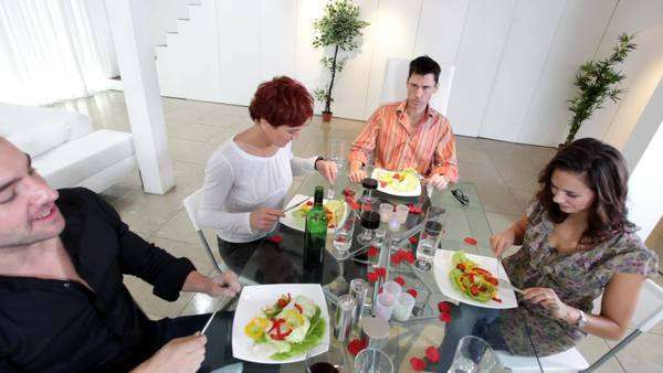 Group of family or friends sit down for a dinner party Royalty-free stock video