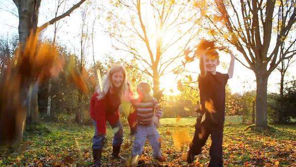Happy family playing outdoors with autumn leaves Royalty-free stock video