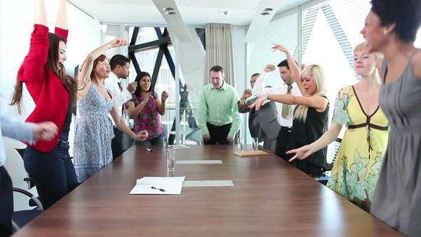 Funny business team dancing in a boardroom meeting Royalty-free stock video