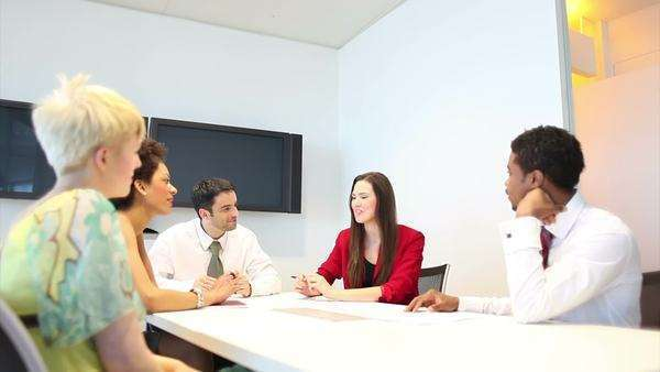Business people in relaxed discussion area in office Royalty-free stock video