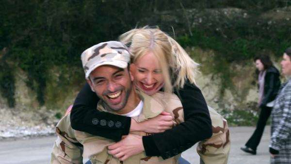 Army soldier returning home to the embrace of his wife Royalty-free stock video