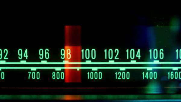 a glowing radio with the marker running through the different stations and frequencies Royalty-free stock video