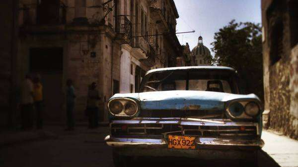 timelapse of a street scene with a classic car in Havana, Cuba Royalty-free stock video