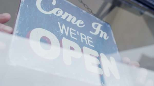 Open' sign is turned to 'Closed' in a storefront window Royalty-free stock video