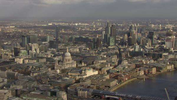 Panoramic aerial view above the city of London and the river thames, featuring some of London's most famous buildings. Royalty-free stock video