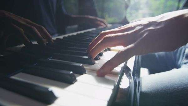 Close up of male hands playing the piano in natural, direct light Royalty-free stock video