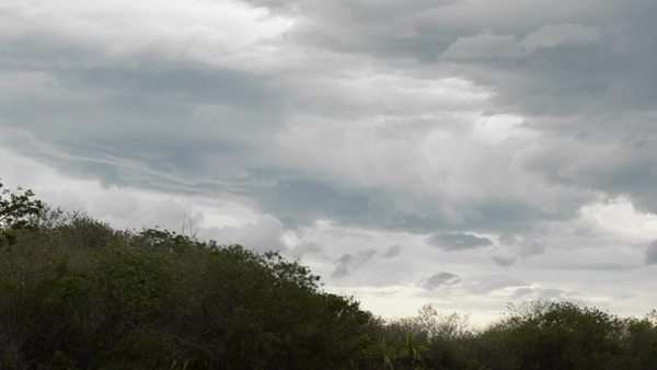 Storm clouds appear over a hilly landscape. Royalty-free stock video