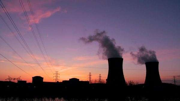 Beautiful timelapse of sunset behind a nuclear power plant. Royalty-free stock video