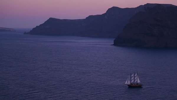 A beautiful sailing ship sails near some islands at night. Royalty-free stock video
