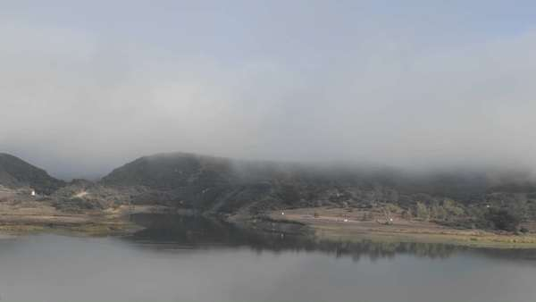 Timelapse of fog and clouds over Lake Casitas in Oak View, California. Royalty-free stock video