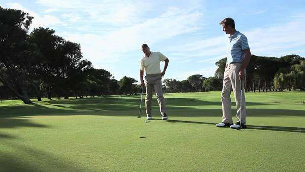 Mature men playing golf on golf course Royalty-free stock video