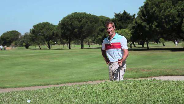 Mature man in sand trap on golf course Royalty-free stock video