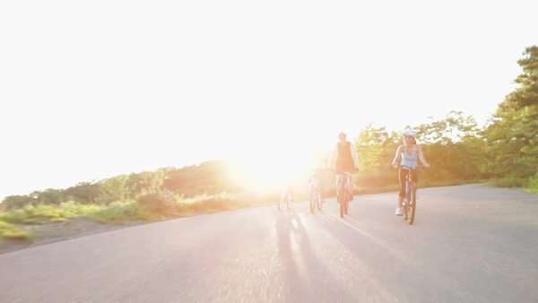 Four cyclists riding along road Royalty-free stock video