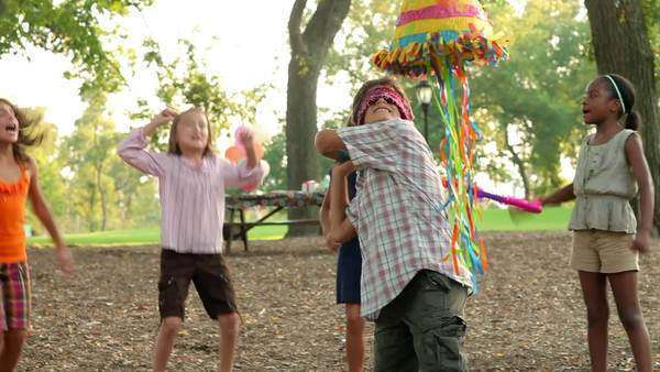 Boy at birthday party hitting piñata Royalty-free stock video