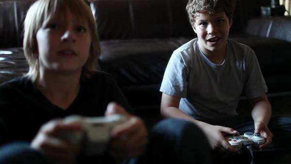 Two boys playing video games Royalty-free stock video