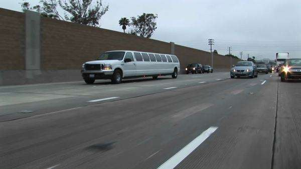 A stretch limo drives down a freeway. Royalty-free stock video