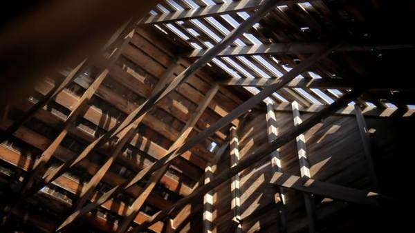 Pattern of light and shadow made by roof beams and missing planks Royalty-free stock video