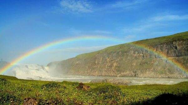 Rainbow over powerful glacial waters of Gulfoss Waterfall, Iceland 60 FPS Royalty-free stock video