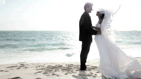 wedding,bride,bridegroom,Caucasian,heterosexual,couple,romance,marriage,luxury,dress,veil,celebration,honeymoon,success,imagination,fashion,commitment,teamwork,love,dreams,travel,oceanside,beach,remote,island,paradise,tropical,caribbean,lifestyle,sunset,flaring Royalty-free stock video