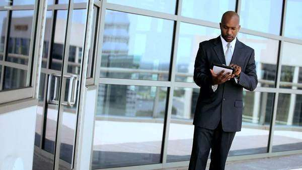 three,multi,ethnic,African American,Caucasian,businesswomen,businessman,executive,city,meeting,modern,workplace,office,building,teamwork,ambitious,successful,career,corporate,global,finance,markets,planning,information,technology,wireless,tablet,computer,visual,touch,screen,navigation,display,online,internet,communication Royalty-free stock video