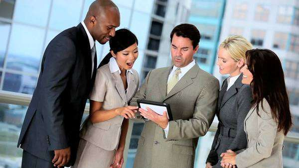multi,ethnic,business,team,five,businesswomen,businessmen,Caucasian,African American,Asian,Chinese,executive,city,clothes,meeting,modern,workplace,office,building,ambitious,successful,career,corporate,global,finance,markets,planning,information,technology,wireless,tablet,visual,touch,screen,navigation,online,internet,communication Royalty-free stock video