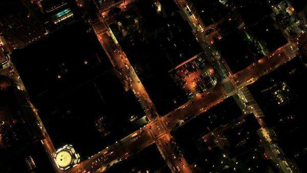 Aerial night vertical rooftop view of city traffic illuminated by city streets and skyscrapers, North America, USA Royalty-free stock video