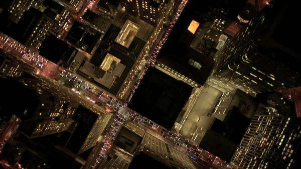 Aerial night vertical view of skyscrapers and streets in an urban illuminated Metropolis Royalty-free stock video
