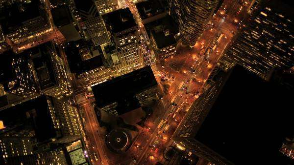 Aerial night vertical view of lights on skyscrapers and streets in an urban city Royalty-free stock video