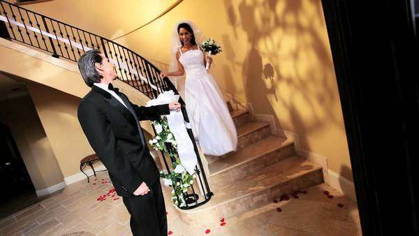 Proud bridegroom waiting bottom luxurious staircase beautiful bride wedding dress Royalty-free stock video