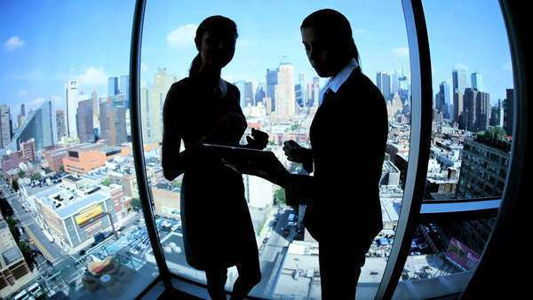 Silhouette successful multi ethnic female business team using touch screen technology in modern city workplace Royalty-free stock video