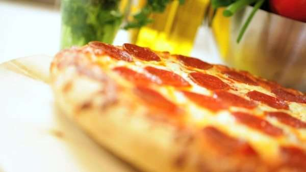 Freshly baked pepperoni pizza a traditional takeaway American meal close up Royalty-free stock video
