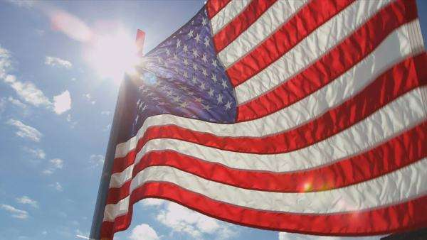 National Flag of America, Stars and Strips, sun flare, USA shot on RED EPIC Royalty-free stock video