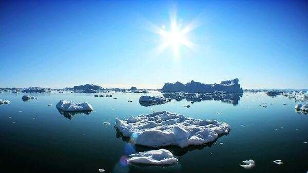 Drifting past icebergs broken from glaciers damaged by climate change Royalty-free stock video