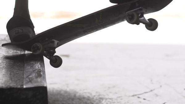 Close-up of skateboarder doing trick along rail. Royalty-free stock video