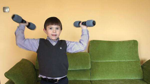 5-6 years boy lifting weights Royalty-free stock video