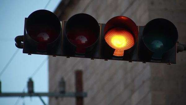 Traffic light changes from green to yellow to red Royalty-free stock video