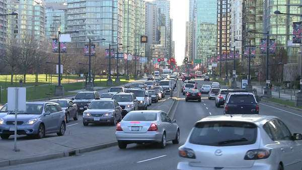 Medium shot of traffic in downtown Vancouver. Royalty-free stock video