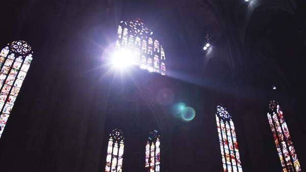 Wide shot of church and windows with sun shinning through Royalty-free stock video